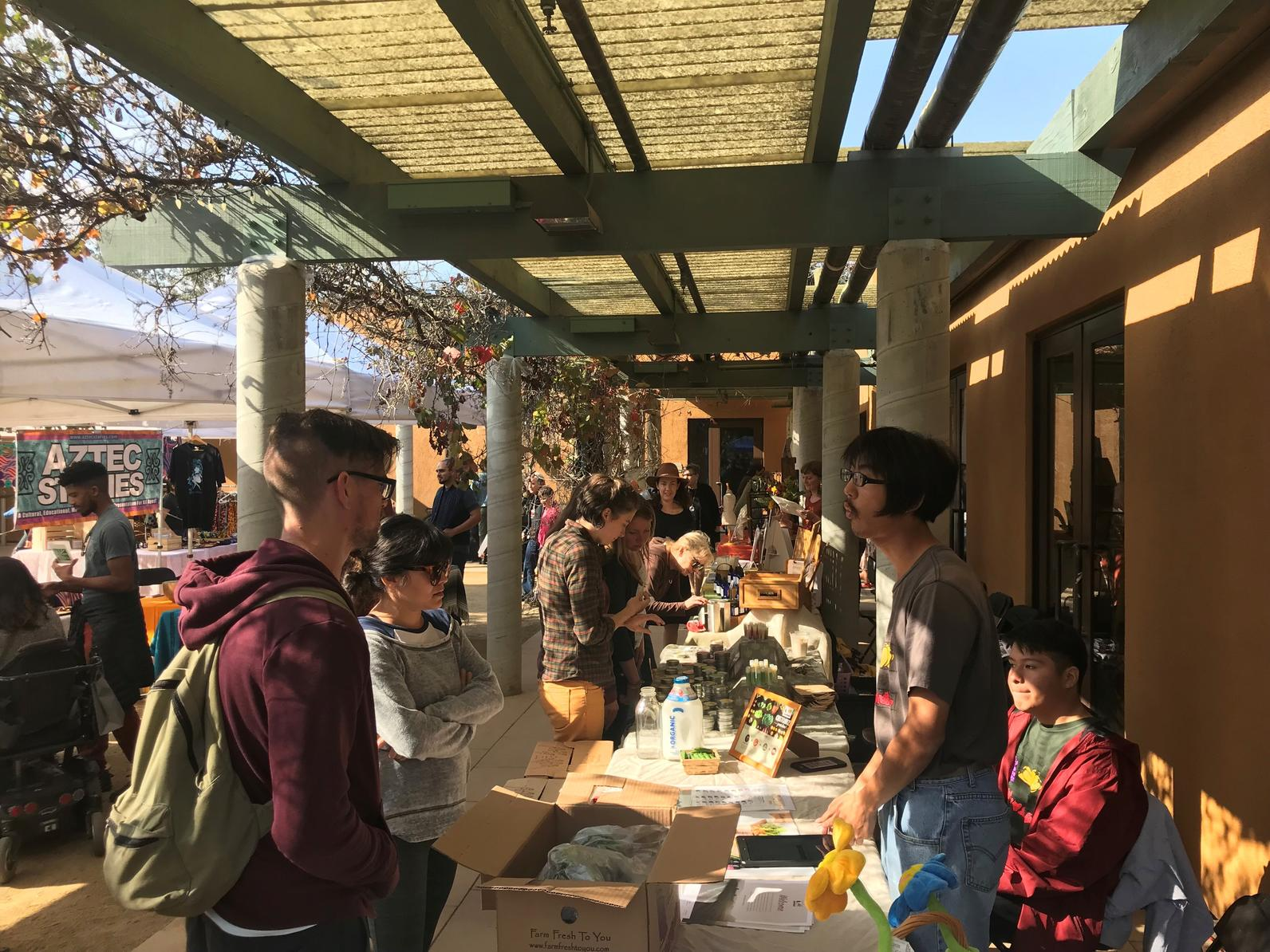 Visitors check out vendor stands at the Arroyo Seco Marketplace