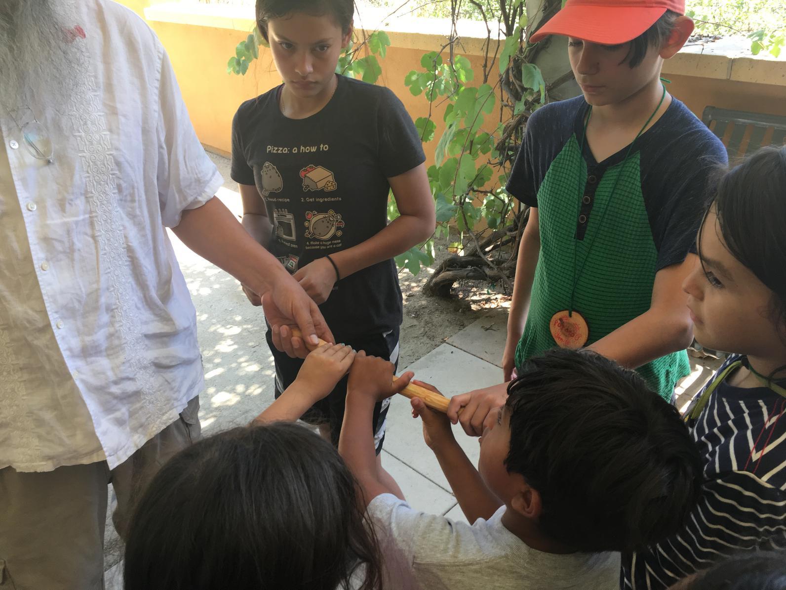 Sanding our Toyon Rhythm Sticks