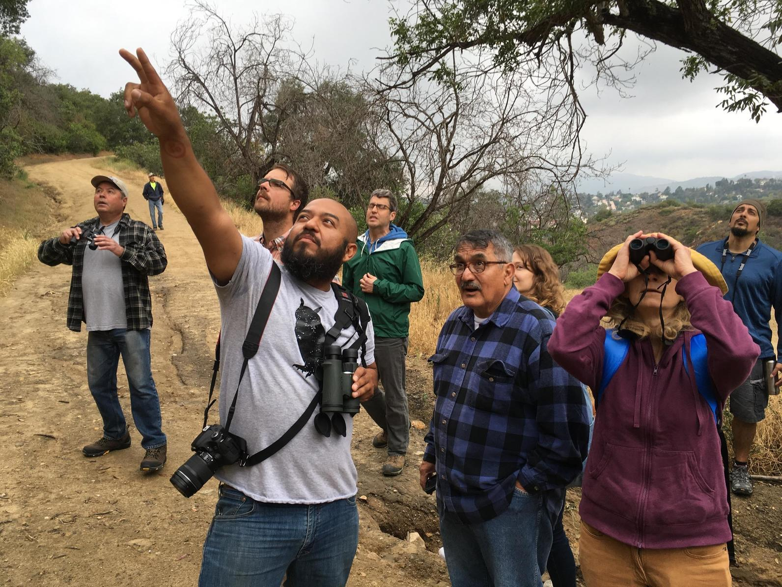 Center Director, Marcos Trinidad leads a group on a bird walk along the Scrub Jay Trail at the Audubon Center at Debs Park.